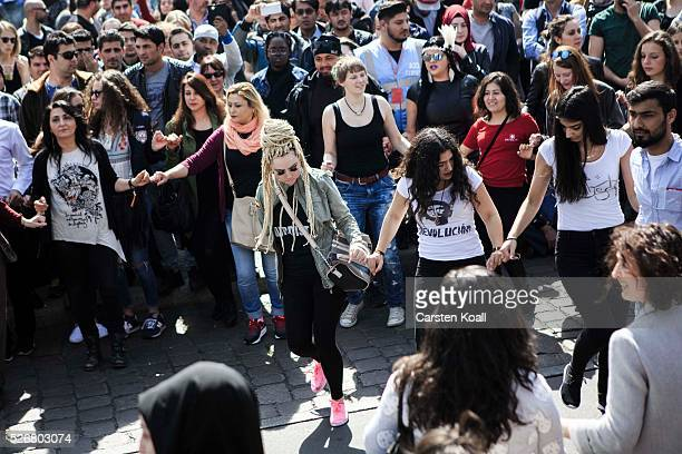People dance at the annual Myfest in District Kreuzberg afternoon before several demonstrations on May 2016 in Berlin Germany Tens of thousands of...