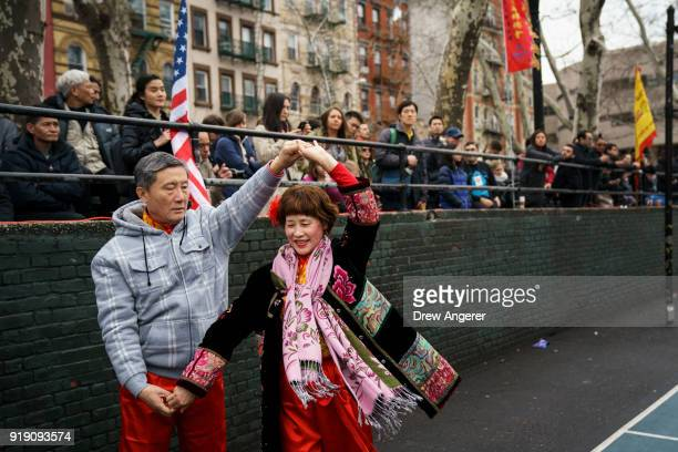 People dance before the start of a firecracker ceremony and cultural festival to mark the first day of the Lunar New Year in Chinatown neighborhood...