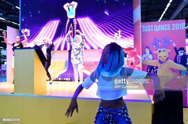 People dance during the 2017 Japan Expo exhibition on July 6, 2017 in Villepinte, near Paris. The 2017 Japan Expo, dedicated to Japanese culture and...