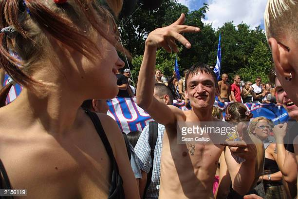 People dance during the annual Love Parade July 12, 2003 in Berlin, Germany. Hundreds of thousands of Techno fans from across Europe danced in the...