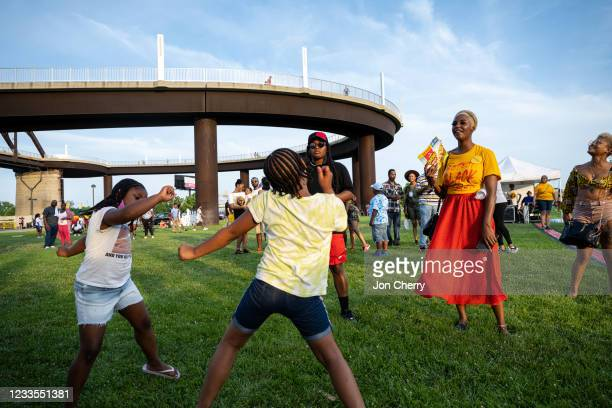 People dance during the Louisville Juneteenth Festival at the Big Four Lawn on June 19, 2021 in Louisville, Kentucky. Juneteenth, or Emancipation...