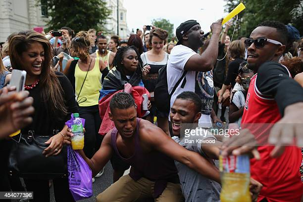 People dance during the Notting Hill Carnival on August 24 2014 in London England The Notting Hill Carnival is the largest street festival in Europe...