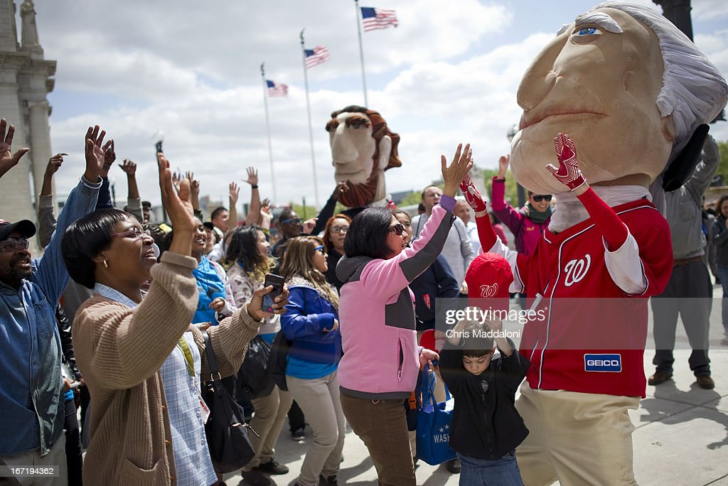 People dance for free Washington Nationals shirts and tickets at an Earth Day 2013 celebration at Union Station.