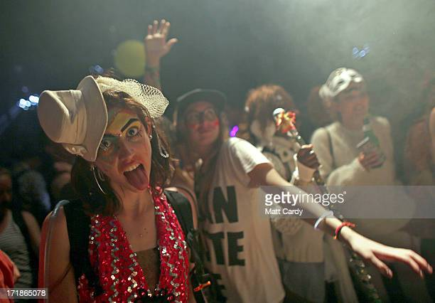 People dance in a nightime venue in the Block 9 area at the Glastonbury Festival of Contemporary Performing Arts site at Worthy Farm Pilton on June...