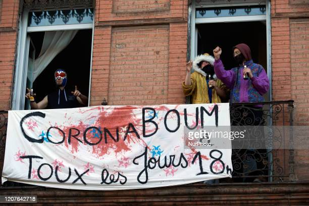 People dance in an appartment with a banner reading 'Corona Boum all days at 18h00' For the 2nd day French people are on lockdown On Monday March...