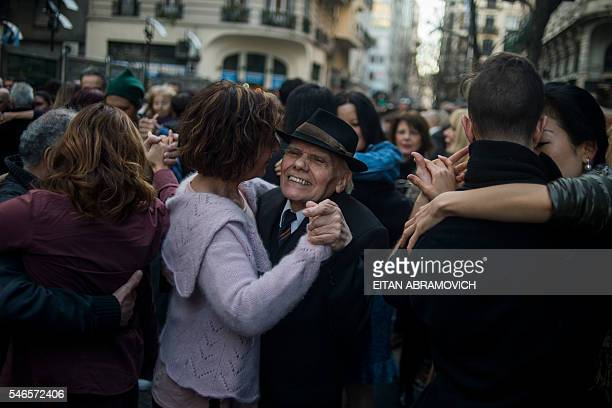 People dance in front of the Buenos Aires City Legislature on July 12 asking for a law allowing the development of independent 'milongas' / AFP /...