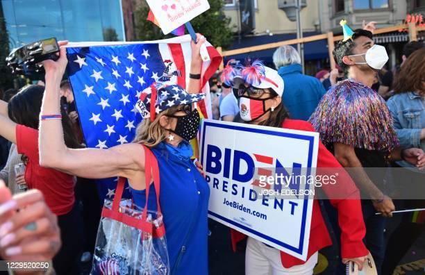 People dance in the street to celebrate Joe Biden being elected President of the United States in the Castro district of San Francisco California on...