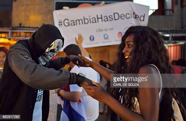 People dance in the streets after hearing of the confirmed departure of former Gambian leader Yahya Jammeh in Banjul on January 21, 2017. Yahya...