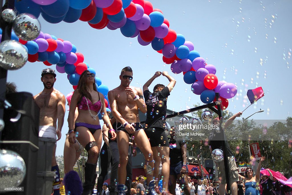 People dance on the AmBi float as bubbles float around them at the LA Pride Parade on June 8, 2014 in West Hollywood, California. The LA Pride Parade and weekend events this year are emphasizing transgender rights and issues. The annual LGBT pride parade begin in 1970, a year after the Stonewall riots, and historically attracts more than 400,000 spectators and participants.