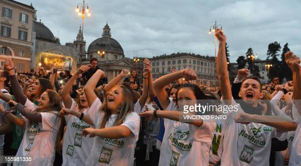 People dance on the 'Gangnam style' song during a flashmob organized at Piazza del Popolo on November 10, 2012 in Rome. Some 5000 people, most of...