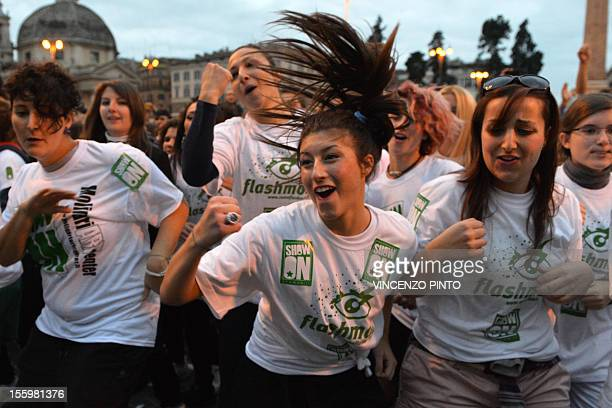 People dance on the 'Gangnam style' song during a flashmob organized at Piazza del Popolo on November 10 2012 in Rome Some 5000 people most of them...