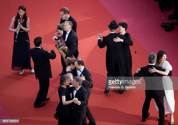 People dance on the red carpet before the screening of 'Capharnaum' during the 71st annual Cannes Film Festival at Palais des Festivals on May 17...