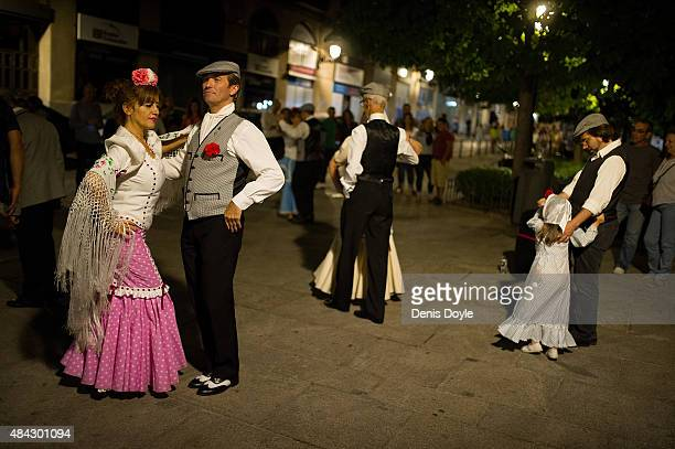 People dance the traditional 'chotis' style in the streets of the historic La Latina neighbourhood during the 'Fiestas de la Paloma on August 14 2015...