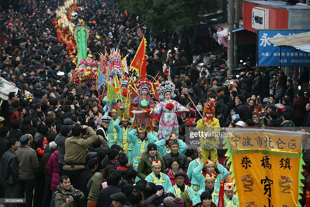 People dance to celebrate the Spring Festival on February 21, 2013 in Ningbo, China. The Chinese Lunar New Year of Snake also known as the Spring Festival, which is based on the Lunisolar Chinese calendar, is celebrated from the first day of the first month of the lunar year and ends with Lantern Festival on the Fifteenth day.