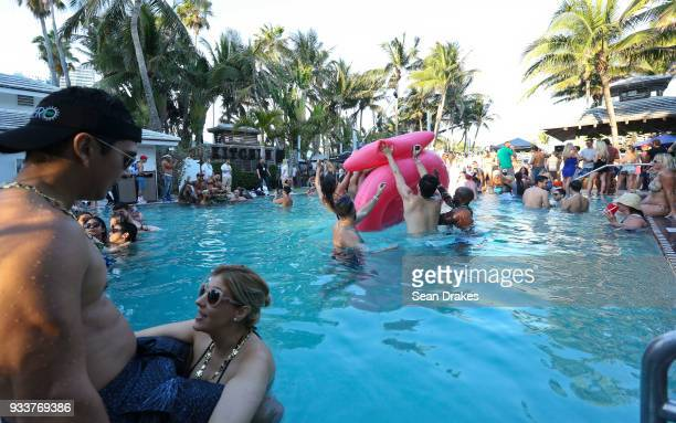 People dance to DJ music during the launch pool party produced by 935FM Revolution Radio Miami at the Nationl Hotel on South Beach as part of Miami...