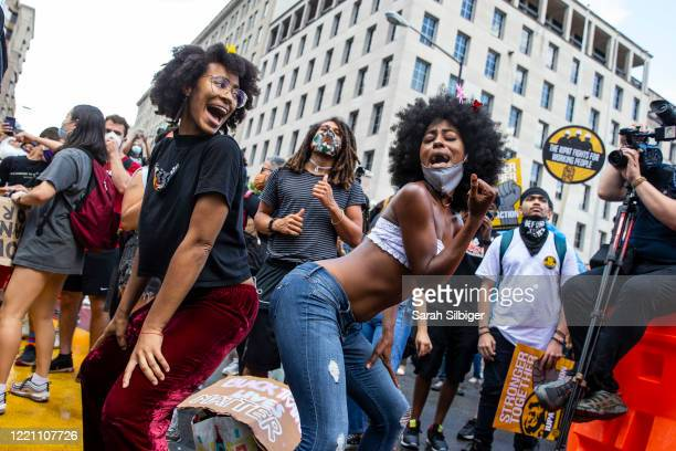 People dance to Gogo music near the Black Lives Matter Plaza to celebrate Juneteenth on June 19 2020 in Washington DC Juneteenth commemorates June 19...
