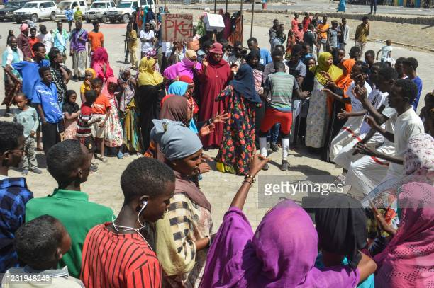People dance to mark the opening of the campaign for the presidential election which will be scheduled on April 9 in Arta, Djibouti, on March 26,...