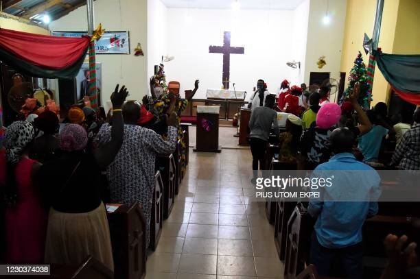 People dance to worship during a crossover night church service at the Anglican Church of Redemption, Diocess of Lagos West, Ibafo in Ogun State...