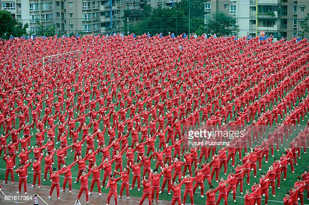 People dance together in a challenge to break a Guinness World Record on November 07 2016 in Chongqing China A total of 50085 dancers performed...