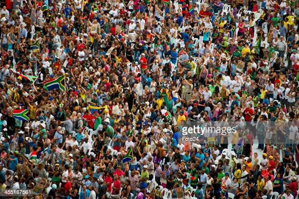 People dancing and enjoying the tribute concert to Madiba on December 11 2013 in Cape Town South Africa Former South African president Nelson Mandela...