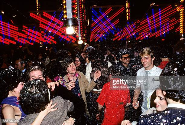 People dancing as confetti falls on New Year's Eve New York New York January 1 1980