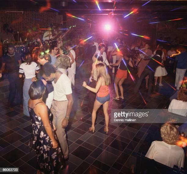 People dancing at disco nightclub