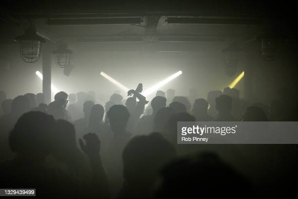People dancing at Egg London nightclub in the early hours of July 19, 2021 in London, England. As of 12:01 on Monday, July 19, England will drop most...