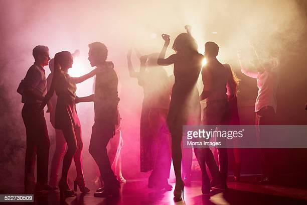 people dancing at nightclub - party stockfoto's en -beelden