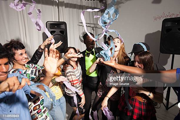 people dancing at party with streamers - streamer stock photos and pictures