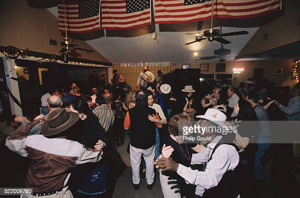 people dancing at zydeco club - accordionist stock pictures, royalty-free photos & images
