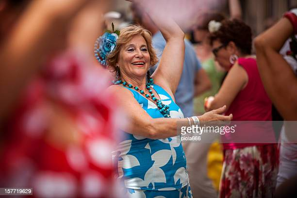 people dancing flamenco in the streets - flamenco dancing stock photos and pictures
