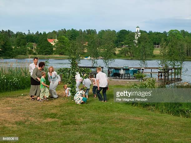 people dancing for midsummer sweden. - midsummer sweden stock pictures, royalty-free photos & images