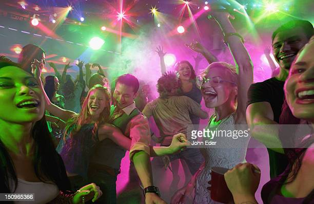 people dancing in a nightclub - dancing stockfoto's en -beelden