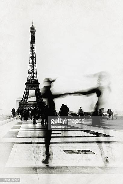 People dancing in front of Eiffel Tower