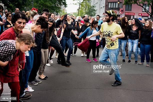 People dancing in the street at the MyFest street fest in immigrantheavy Kreuzberg district on May Day on May 1 2014 in Berlin Germany May Day the...