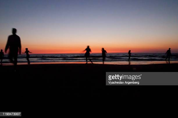 people dancing on the beach late at night, morjim, goa - argenberg stock pictures, royalty-free photos & images