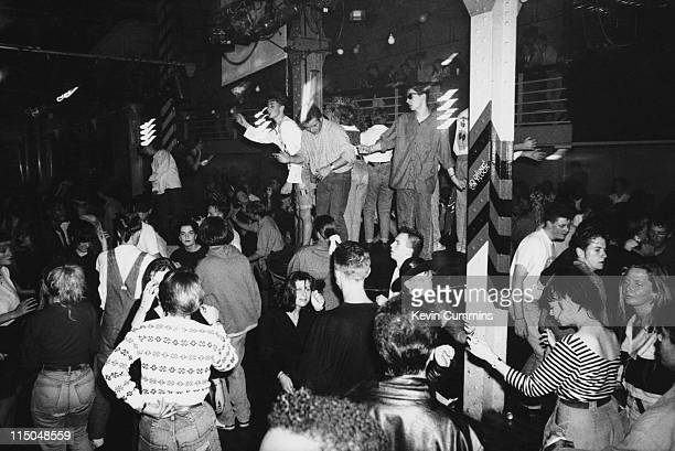 People dancing to acid house music at the Hacienda night club in Manchester circa 1988