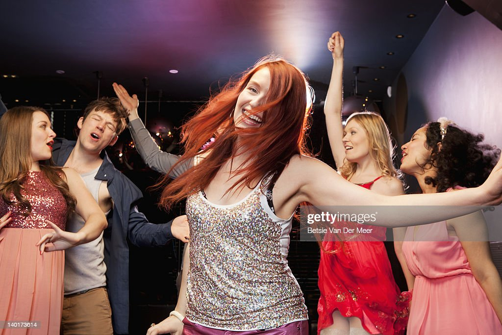 People dancing,partying in nightclub. : Stock Photo