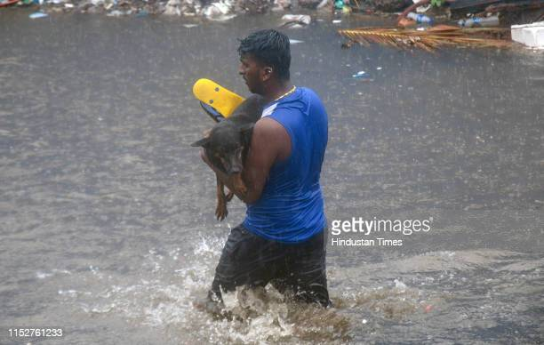 People deal with rain at Andheri Subway on June 28 2019 in Mumbai India Several areas of Mumbai woke up to heavy downpour today with the weather...