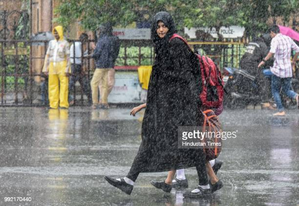 People deal with rain at CSMT on July 4 2018 in Mumbai India Heavy rains made a comeback in Mumbai causing waterlogging in many parts of the city...