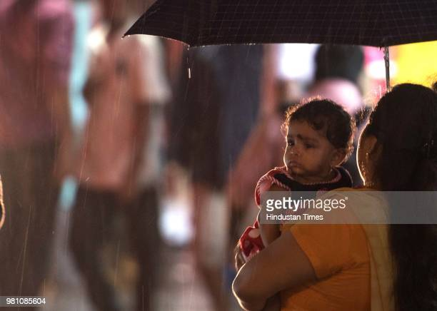 Children wear raincoat on monsoon at Bandstand Bandra on June 21 2018 in Mumbai India This year the southwest monsoon reached Mumbai on June 9 a day...