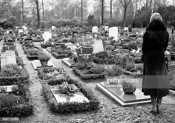 people death mourning churchyard young woman stands at a tomb aged 25 to 30 years Monika