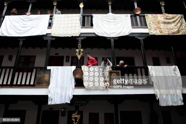 People decorate with shawls and paintings of saints the 'Corrala de Santiago' preparing it for the upcoming 'Dia de la Cruz' El día de la Cruz or Día...