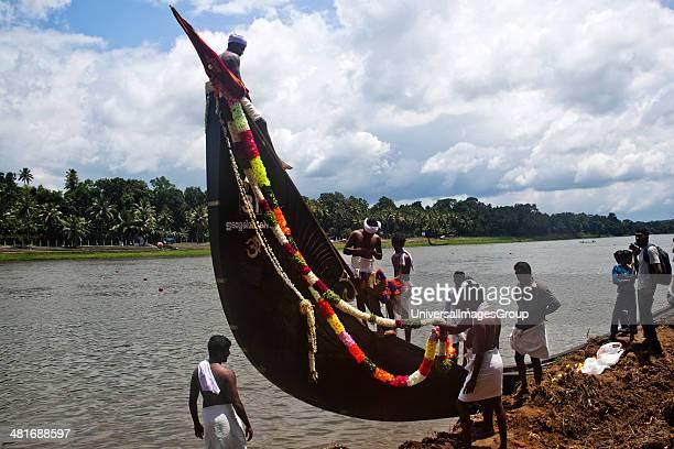 People decorating a Snake boat during Onam Festival Aranmula Kerala India