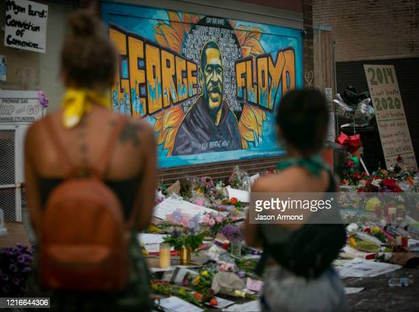 People defy the curfew to pay their respects at the makeshift memorial and mural outside Cup Foods where George Floyd was murdered by a Minneapolis...