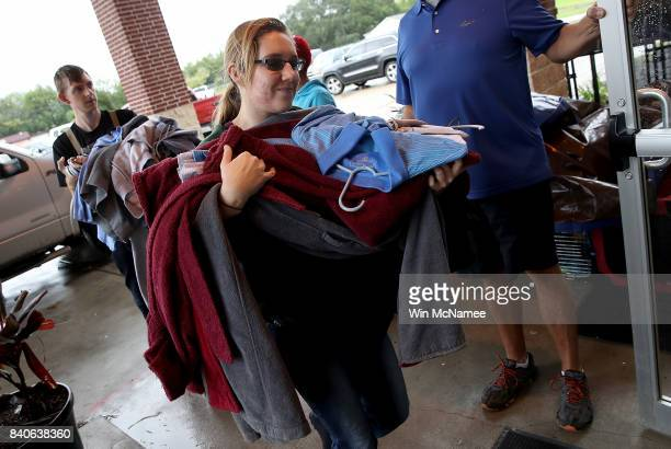 People deliver donated emergency supplies at the Church on Masters Road temporary shelter August 29 2017 in Manvel Texas Thousands of Houston area...