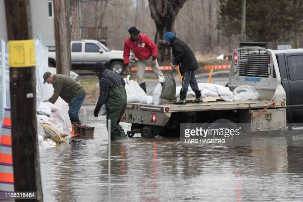 People deliver sand bags around a church in Gatineau Quebec on April 20 2019 to prepare for the spring flooding
