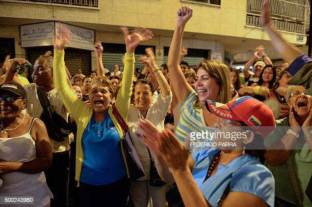 People demand the closure of an empty polling station in Caracas on December 6 2015 during Venezuela's legislative election The National Electoral...