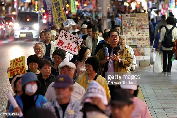 People demanding the early return of the US Air Station Futenma march on during the rally on the 20th anniversary of the agreement of the air base...