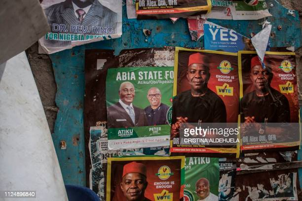 TOPSHOT People Democratic Party posters adorn a wall in Aba a city in one of the proBiafran separatist regions on February 14 2019 Nigerians are...